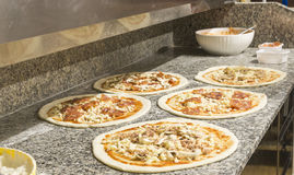 Making pizzas Stock Images