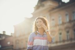Making plans to meet a friend in the city. royalty free stock images