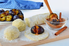 Making plum dumplings filled with cinnamon sugar Stock Photo