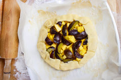 Making plum and pumpkin galette Stock Image