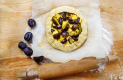 Making plum and pumpkin galette Royalty Free Stock Photos
