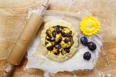 Making plum and pumpkin galette Royalty Free Stock Image