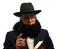 Making a point. An Amish man holding a Bible making a point,over white Royalty Free Stock Images