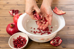 Making pomegranate juice Royalty Free Stock Image