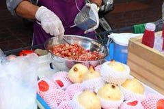 Making pomegranate juice on street market, Thailand, Bangkok Royalty Free Stock Images