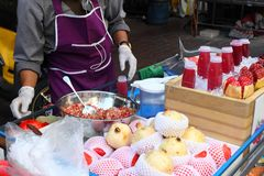 Making pomegranate juice on street market, Thailand, Bangkok Stock Photo