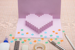 Making  pop-card  in the form of heart. Royalty Free Stock Images