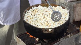Making popcorn in a carnival for selling Royalty Free Stock Images