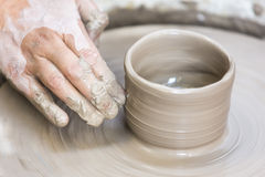 Making a pottery cup on the wheel Royalty Free Stock Images