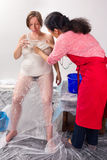 Making a pregnancy belly cast Stock Images