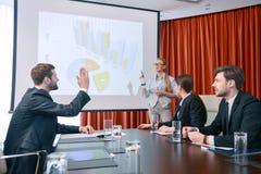 Making a presentation at meeting Royalty Free Stock Photography