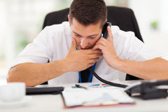 Making private call. Office worker making a private call with a company phone Stock Photos