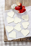 Making puff pastry cookies in heart shape filled with strawberri Royalty Free Stock Image