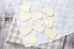 Making puff pastry cookies in heart shape Royalty Free Stock Photography