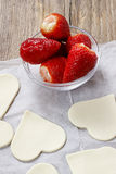 Making puff pastry cookies in heart shape Stock Images