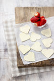 Making puff pastry cookies in heart shape Royalty Free Stock Image