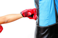 Making a punch on a sandbag Royalty Free Stock Images
