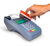 Making a purchase with credit card reader.. Swiping a credit card through a credit card reader. Clipping path included. Credit card terminal Royalty Free Stock Image