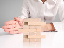 Making  pyramid with empty wooden cubes Stock Image