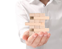 Making  pyramid with empty wooden cubes Royalty Free Stock Photos