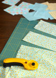 Making a quilt. Cutting fabric with rotary cutter Royalty Free Stock Image