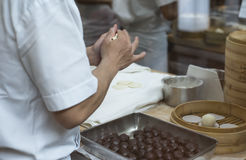 Making Red Bean Bun. Making of red bean paste bun. The bun will be steamed and normally eaten as dessert Stock Image