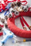 Making red christmas wreath diy handmade Royalty Free Stock Photo