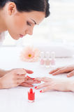 Making red manicure. Royalty Free Stock Photography