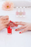 Making red manicure. Stock Photo