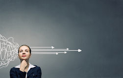 Making right desicion. Thoughtful businesswoman and drawn arrow thoughts out of her head Stock Image