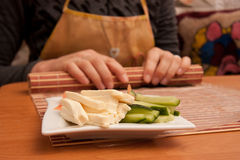 Making Rolled Sushi in a Bamboo Sushi Mat Stock Image