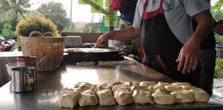 Making roti canai Royalty Free Stock Photo