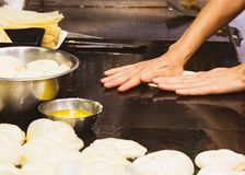 Making of Roti Canai, cooking process, Indian traditional street food stock photo