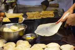 Making of Roti Canai, cooking process, Indian traditional street food stock image
