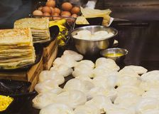 Making of Roti Canai, cooking process, Indian traditional street food stock photography