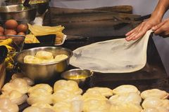 Making of Roti Canai, cooking process, Indian traditional street food royalty free stock photo