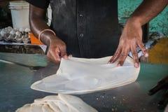Making of Roti Canai, Roti cooking process, roti fried indian food stock photo