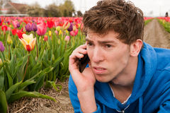 Making a sad phone call Royalty Free Stock Image