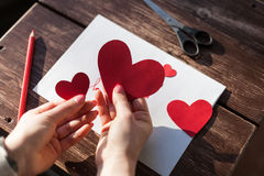 Making a Saint Valentine decoration hearts Stock Photos