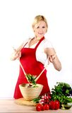 Making salad. Healthy eating woman in the kitchen making a salad Royalty Free Stock Photography