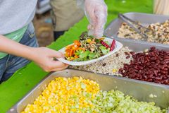 Making salad mix vegetable and grain nut. Making salad with vegetable and grain nut for healthy food stock photography