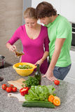 Making salad with olive oil Stock Images