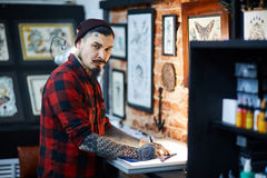 Making sample tattoo sketches Stock Photography