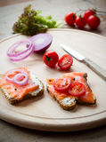 Making a sandwich. With smoked salmon Royalty Free Stock Images