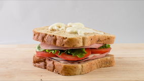 Making sandwich with tomato, salad, ham, stop motion stock video footage