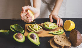 Making sandwiches with avocado healthy organic food Stock Images