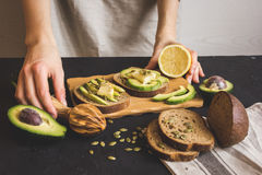 Making sandwiches with avocado healthy organic food Royalty Free Stock Photos