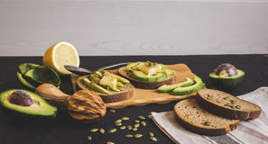 Making sandwiches with avocado healthy organic food Royalty Free Stock Image