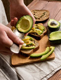 Making sandwiches with avocado healthy organic food Royalty Free Stock Photo