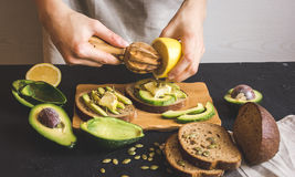 Making sandwiches with avocado healthy organic food Stock Photo